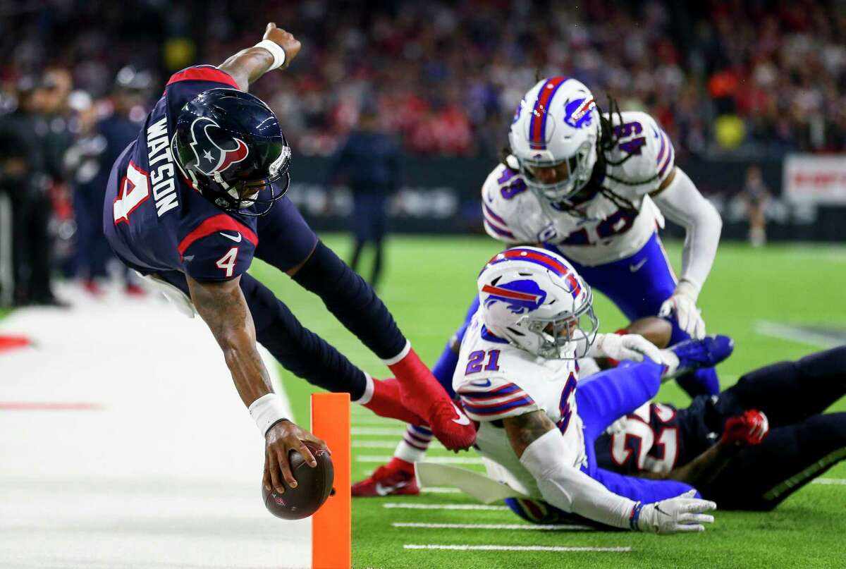 Houston Texans quarterback Deshaun Watson (4) stretches the ball across the goal line to get a two-point conversion against the Buffalo Bills during the third quarter of an AFC Wild Card playoff game at NRG Stadium Saturday, Jan. 4, 2020, in Houston.