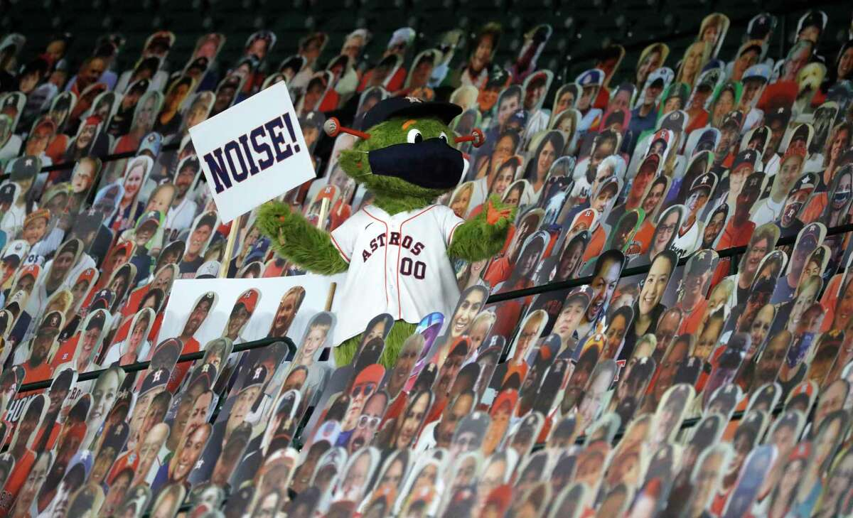 Houston Astros mascot Orbit tries to get the fan cutouts to make some noice during the second inning of an MLB baseball game at Minute Maid Park, Monday, August 24, 2020, in Houston.