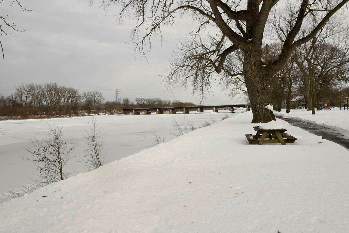 Snow covers the Mohawk River near the stockade on Wednesday, Dec. 23, 2020 in Schenectady, N.Y. Flooding is a concern with warmer temperatures and rain in the next couple days. (Lori Van Buren/Times Union)