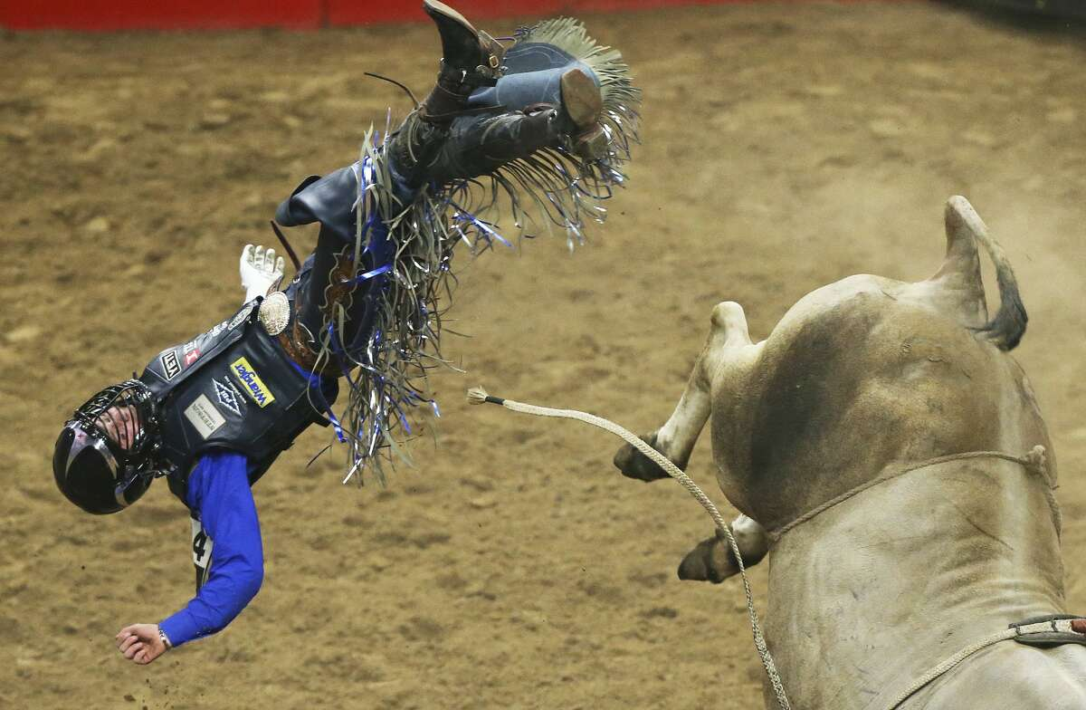 Stetson Wright gets pitched for a no score in the bull riding event during the Rodeo semifinals at the AT&T Center.