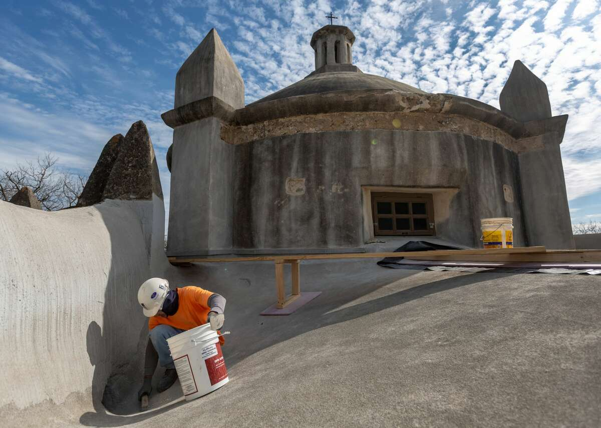Bill Garcia cleans up loose material Tuesday, Jan. 21, 2020, from the roof of Mission Concepcion. The 1750s-era church is closed for the next few months while repair work is done on the building's dome.