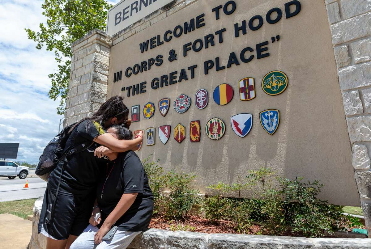Gloria Guillén, seated, is comforted Tuesday, June 23, 2020 in Killeen by her daughter Lupe Guillén after she spoke at the Fort Hood main gate about her then-missing daughter, Fort Hood soldier Pfc. Vanessa Guillén.