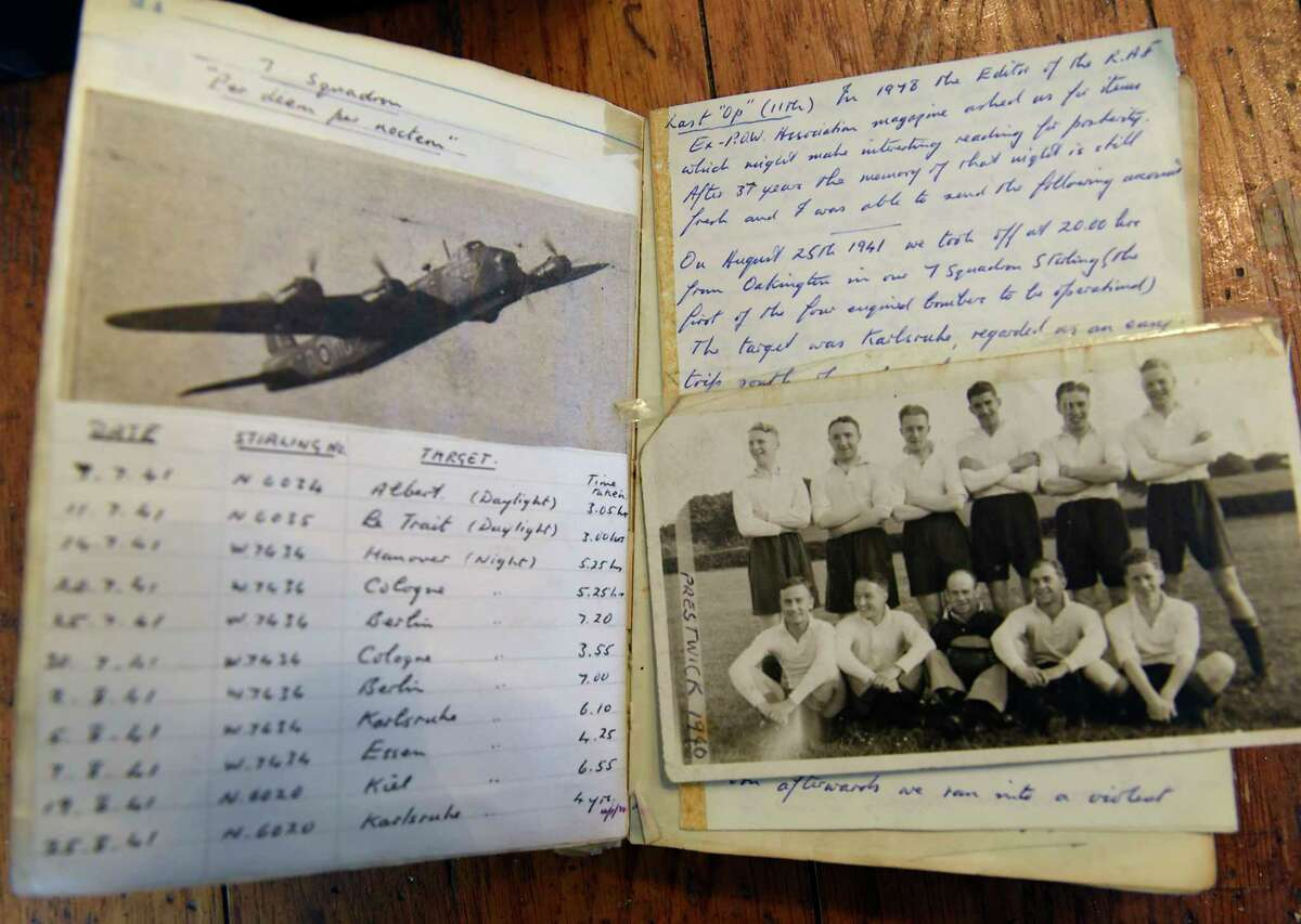 Iain Walker has memorabilia, like this diary, from his grandfather, a British airman, who was shot down over Europe in WWII on Thursday, Dec. 17, 2020 in Niskayuna, N.Y. (Lori Van Buren/Times Union)