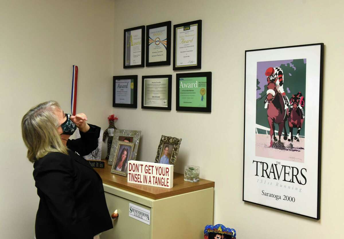 Kelly DeFeciani, Shenendehowa communications director, who is known as the 'Grapevine Lady' looks at some the awards she's received on Wednesday, Dec. 23, 2020, at the district offices in Clifton Park, N.Y. She is planning to retire. (Will Waldron/Times Union)