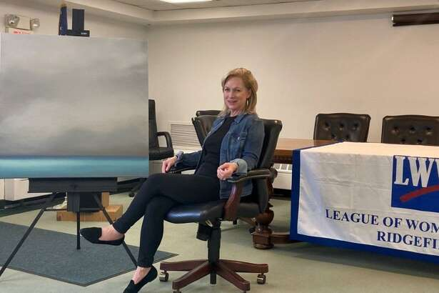 Ridgefield Artist Tina Cobelle-Sturges is pictured with the painting she donated for the League of Women Voters of Ridgefield Art Raffle. The non-partisan organization is going to hold the fundraiser during a virtual event January 12, at 11 a.m. in conjunction with Ridgefield Suffragist Alice Paul's birthday.