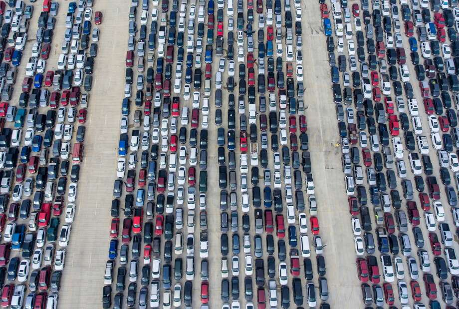 People wait in their cars Thursday, April 9, 2020, at Traders Village for the San Antonio Food Bank to begin food distribution. Photo: William Luther/Staff / ?2020 San Antonio Express-News