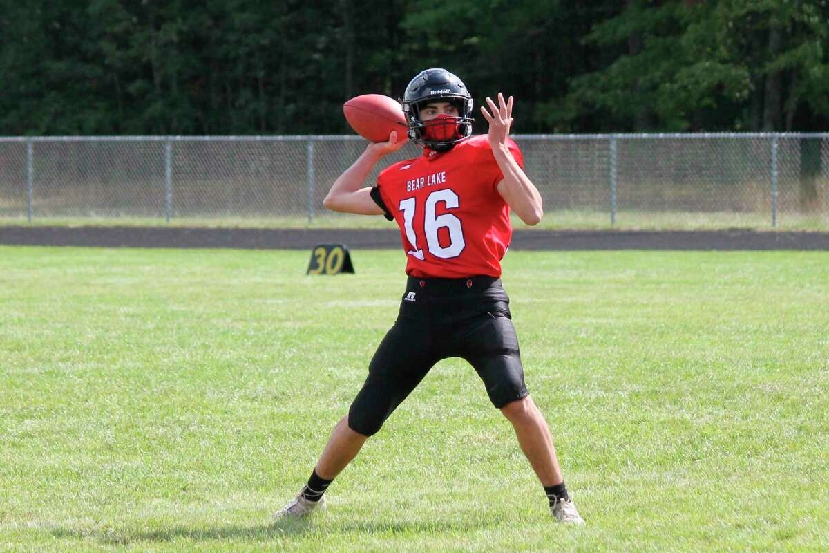 Bryce Harless looks downfield while playing quarterback against Ashely on Sept. 19. (News Advocate File Photo)