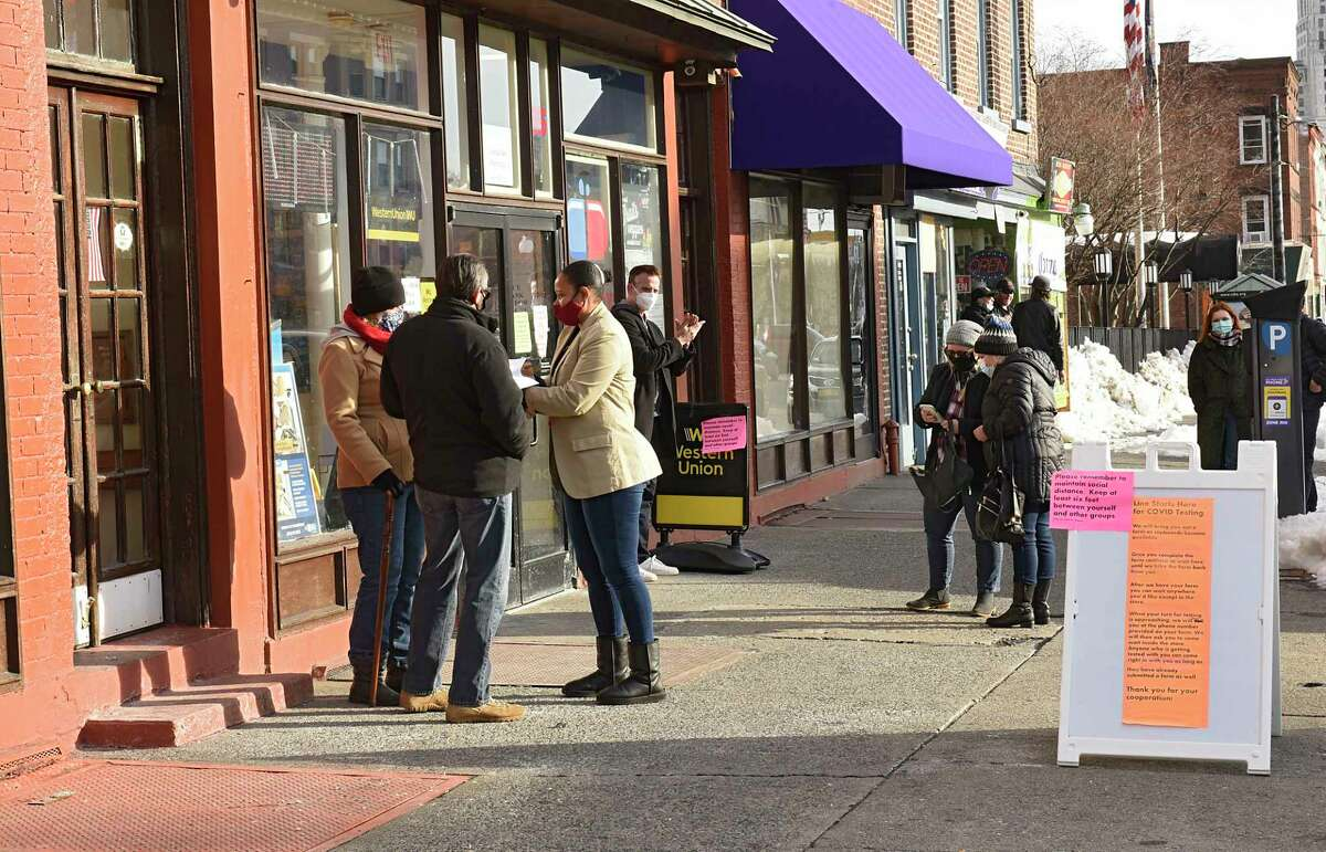 People are seen waiting outside Central Ave. Pharmacy where COVID-19 testing is offered on Wednesday, Dec. 23, 2020 in Albany, N.Y. (Lori Van Buren/Times Union)