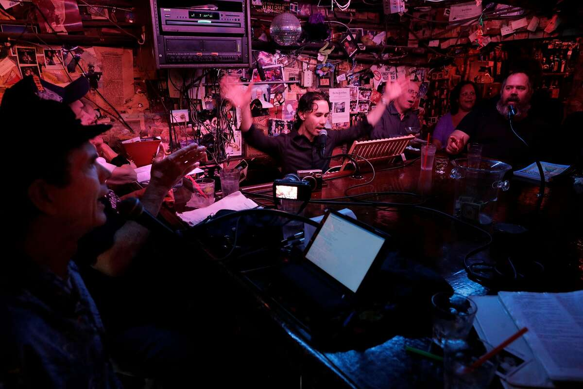Bryan Seet (center), who succeeded Rod Dibble as featured pianist at the Alley, plays there in 2018. He and loyal regulars are trying to save the historic venue from permanent closure.