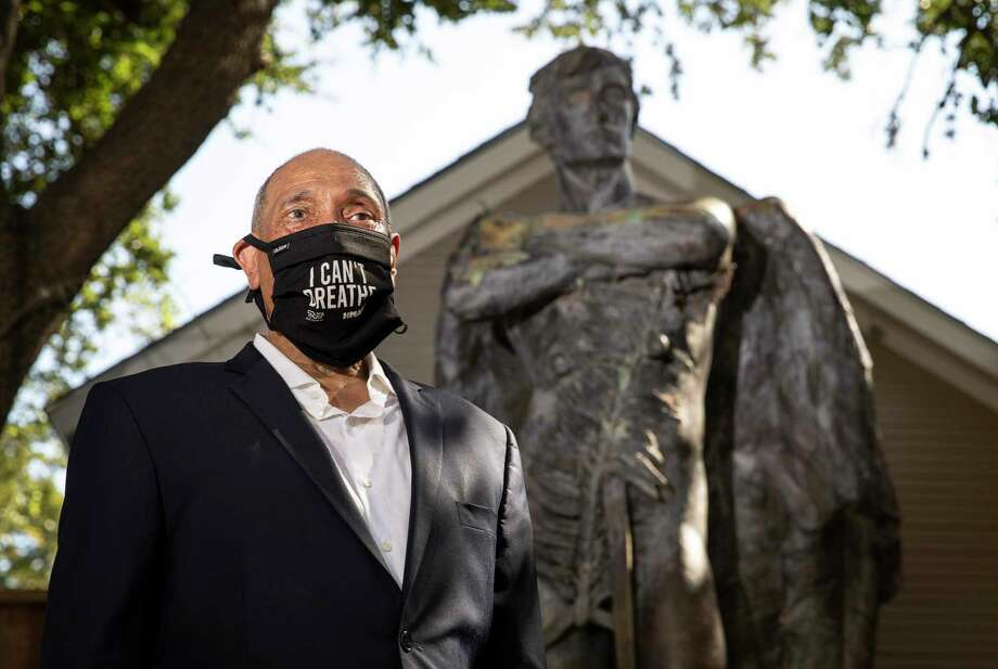 "John Guess, Jr., CEO of the Houston Museum of African American Culture, poses for a portrait next to ""Spirit of the Confederacy,"" the statue removed from Sam Houston Park in June, on Tuesday, Aug. 18, 2020, at the museum in Houston. ""This isn't about the monument. It's about having a multi-cultural conversation on race,"" Guess said. Photo: Jon Shapley, Staff Photographer / © 2020 Houston Chronicle"
