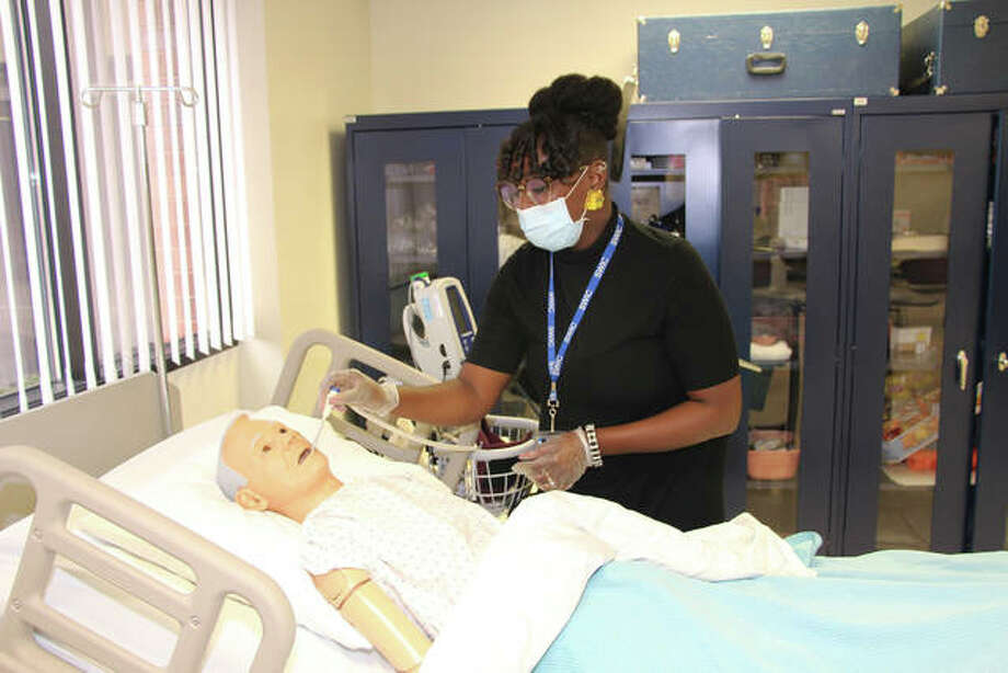 A SWIC Practical Nursing student at the East St. Louis Higher Education Campus practices her skills using a patient simulator Photo: Courtesy Of SWIC