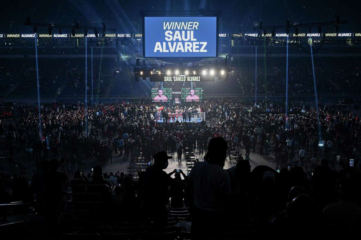 This image provided by Matchroom shows a general view as Canelo Alvarez celebrates after defeating Callum Smith in their super middleweight title bout at the Alamodome on December 19, 2020, in San Antonio.