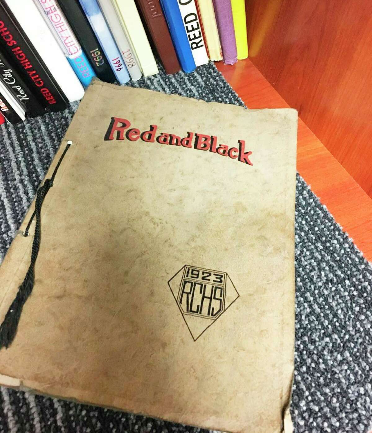 A Reed City High School yearbook published in 1923 was recently discovered by school staff during a deep clean of the school library. Despite signs of aging and some dog-eared pages, the yearbook remains in good condition. (Courtesy photo)