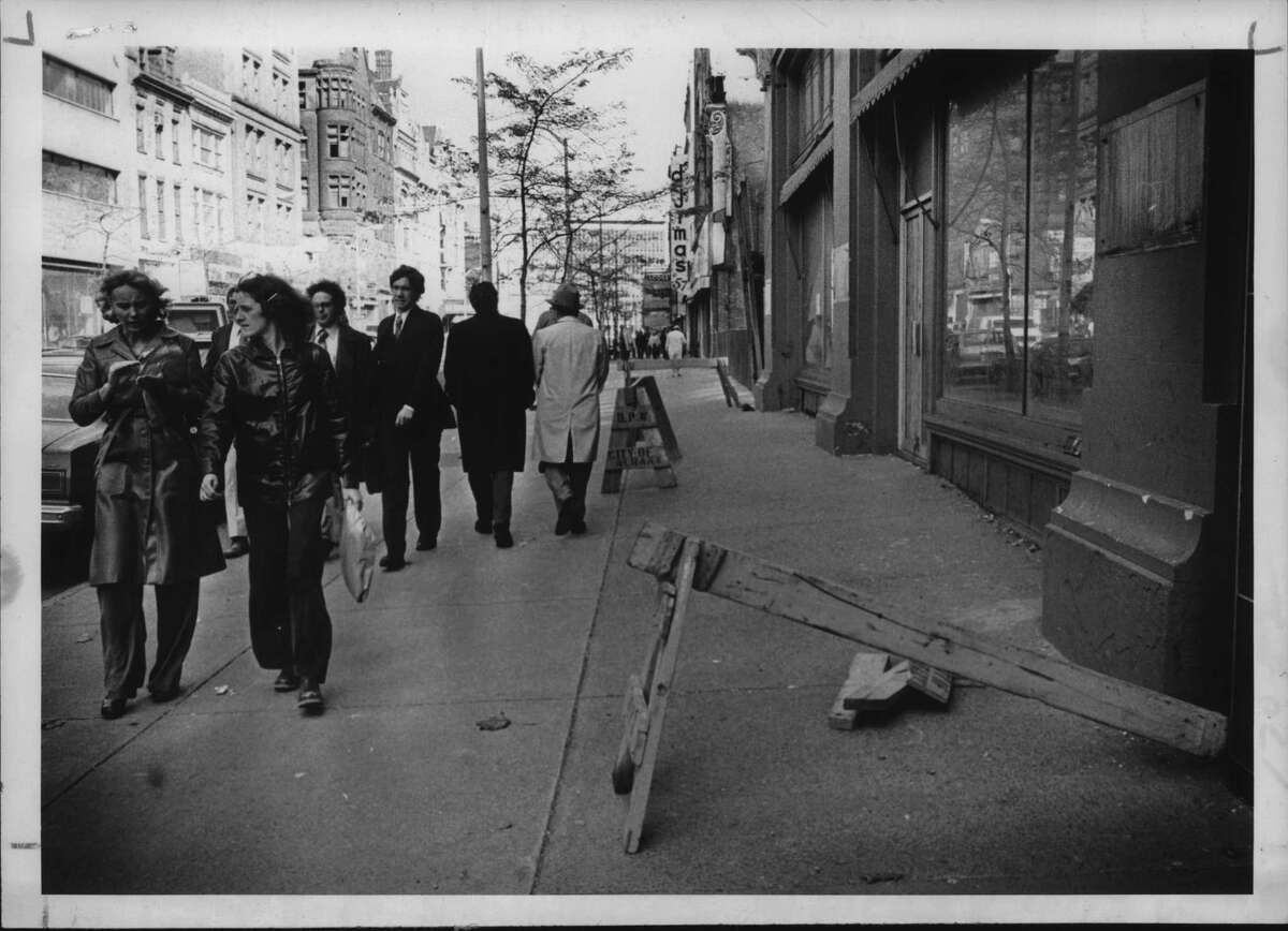 Albany, New York pedestrians pass former John G. Myers store. October 26, 1978 (Bob Richey/Times Union Archive)