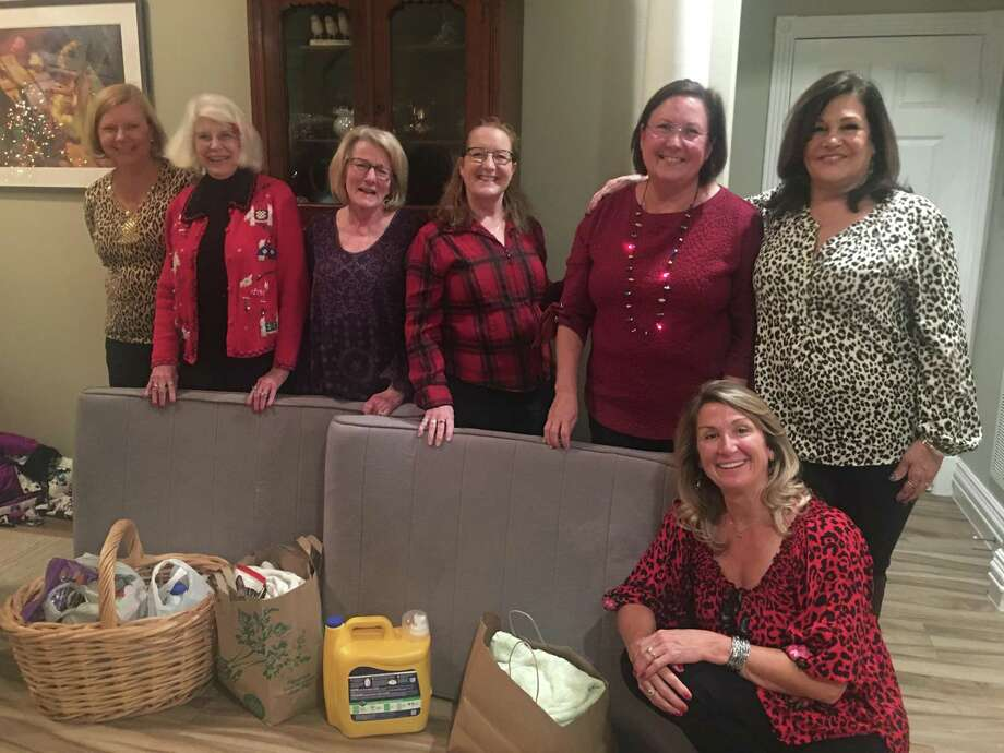 Pictured, left to right, Leslie Brady, Marie Underdown, Karen Dwyer, Carole Bradley, Audrey Markos, Corinne Dunn, Dundee Kuhasz with some of the items donated to SPCA PETS SNAP of MC by the Women of Waterford Estates at their annual Christmas Party. Photo: Courtesy Photo