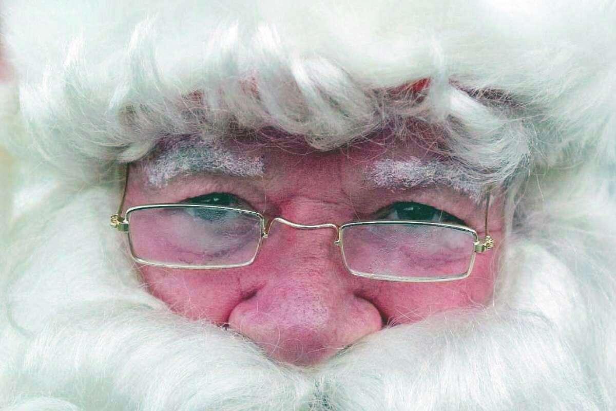 Dec. 24, 2011 file photo. Jerry DeJulia has played Santa Claus on Christmas Eve since 1964.