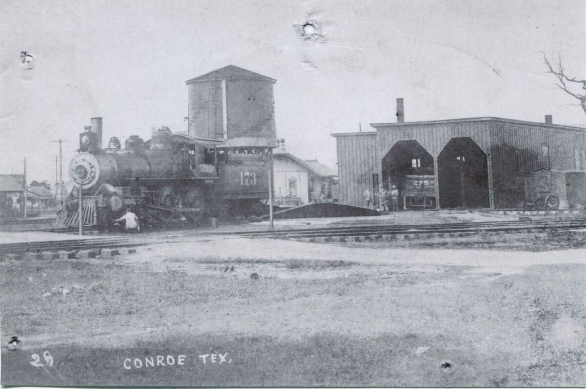 """The Santa Fe railroad roundhouse circa 1920 near Pacific Street in downtown Conroe. According to memories from Cedric N. Nutter that were written in """"A Silhouette of Conroe, Texas 1976"""" on New Year's Eve the engineers at the Conroe roundhouse would blow the train horns and make lots of noise at midnight on New Year's Eve."""