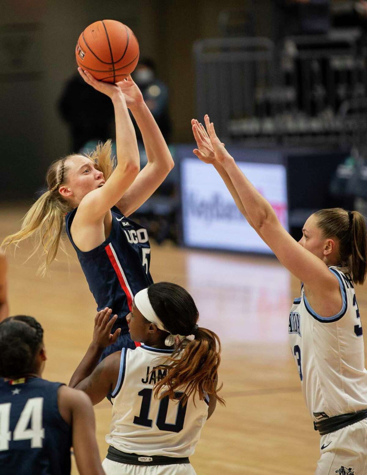 UConn guard Paige Bueckers (5) shoots over Villanova forward Sarah Mortensen during the second half on Tuesday.