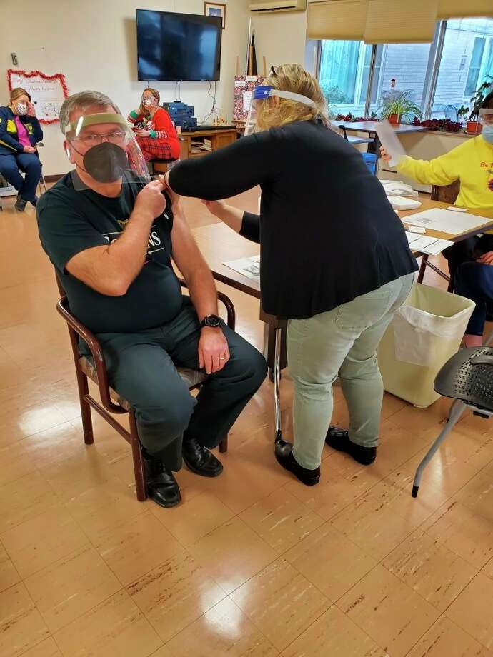 Manistee County Medical Care Facility administrator Joe Coleman receives a COVID-19 vaccination. Staff and residents at the facility were among the first in the county to be vaccinated for coronavirus. (Courtesy photo/Joe Coleman)