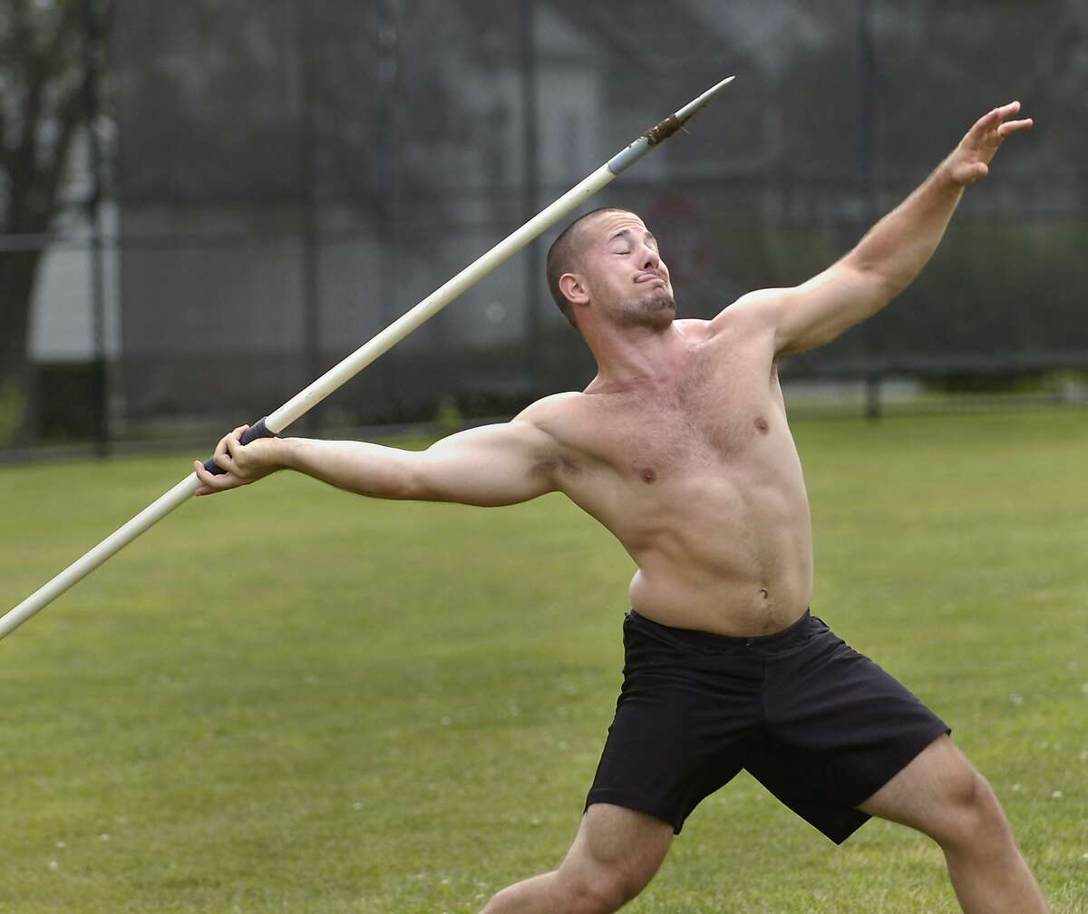 A graduate of Stamford High School throws the javelin on the field while training to compete in the Nutmeg Games in Danbury in this 2009 picture.