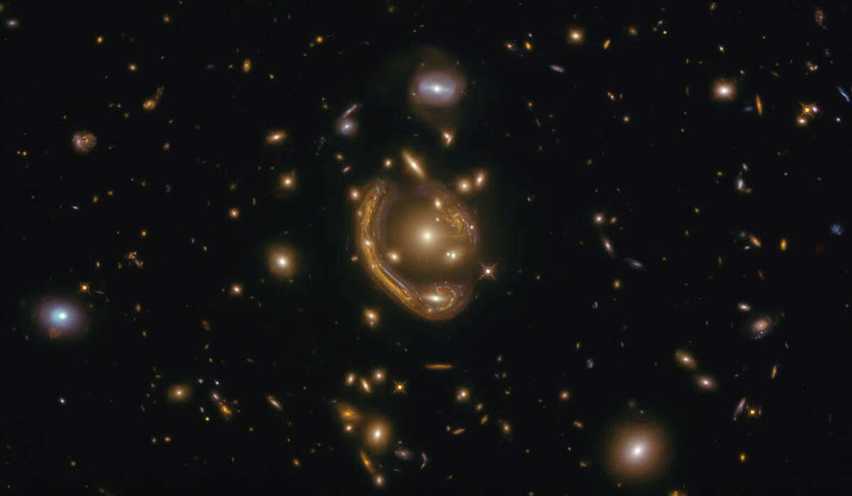 The narrow galaxy elegantly curving around its spherical companion in this image is a fantastic example of a rare phenomenon. This image was taken with the NASA/ESA Hubble Space Telescope.