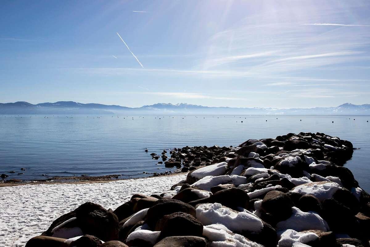 Ducks enjoy a snowy beach along the recreation area in Tahoe Vista, which has been shut down through December.