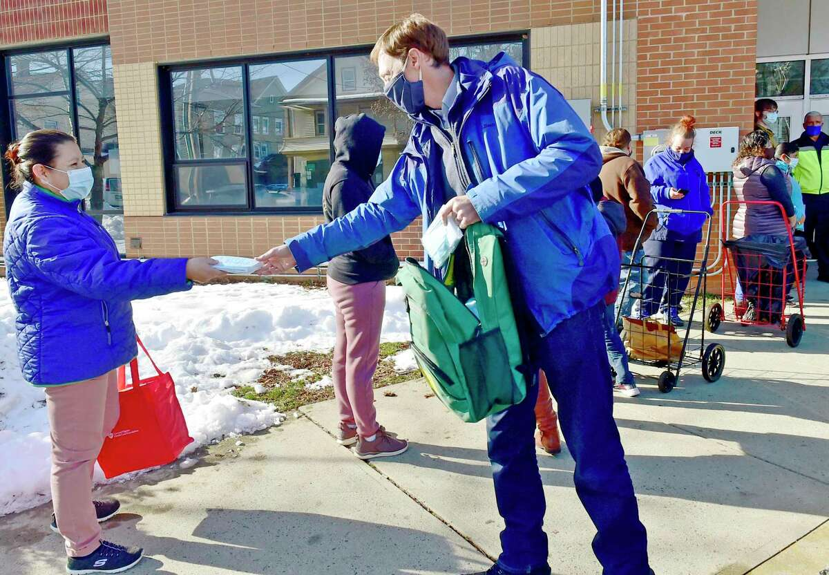 New Haven Mayor Justin Elicker distributes extra masks at the Columbus Academy School as the New Haven Public Schools distributes preventative face masks Dec. 23, 2020 for New Haven Public Schools students at the Columbus Academy School to help prevent the spread of COVID-19 in Fair Haven.