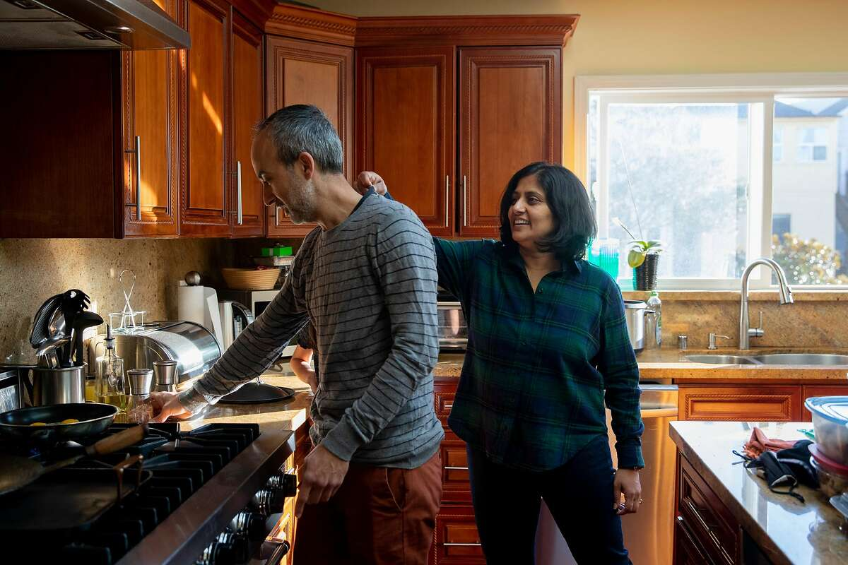 UCSF's Dr. Madhavi Dandu (right) has gotten the vaccine, and husband Dr. Nima Afshar is set to get his first shot next week.