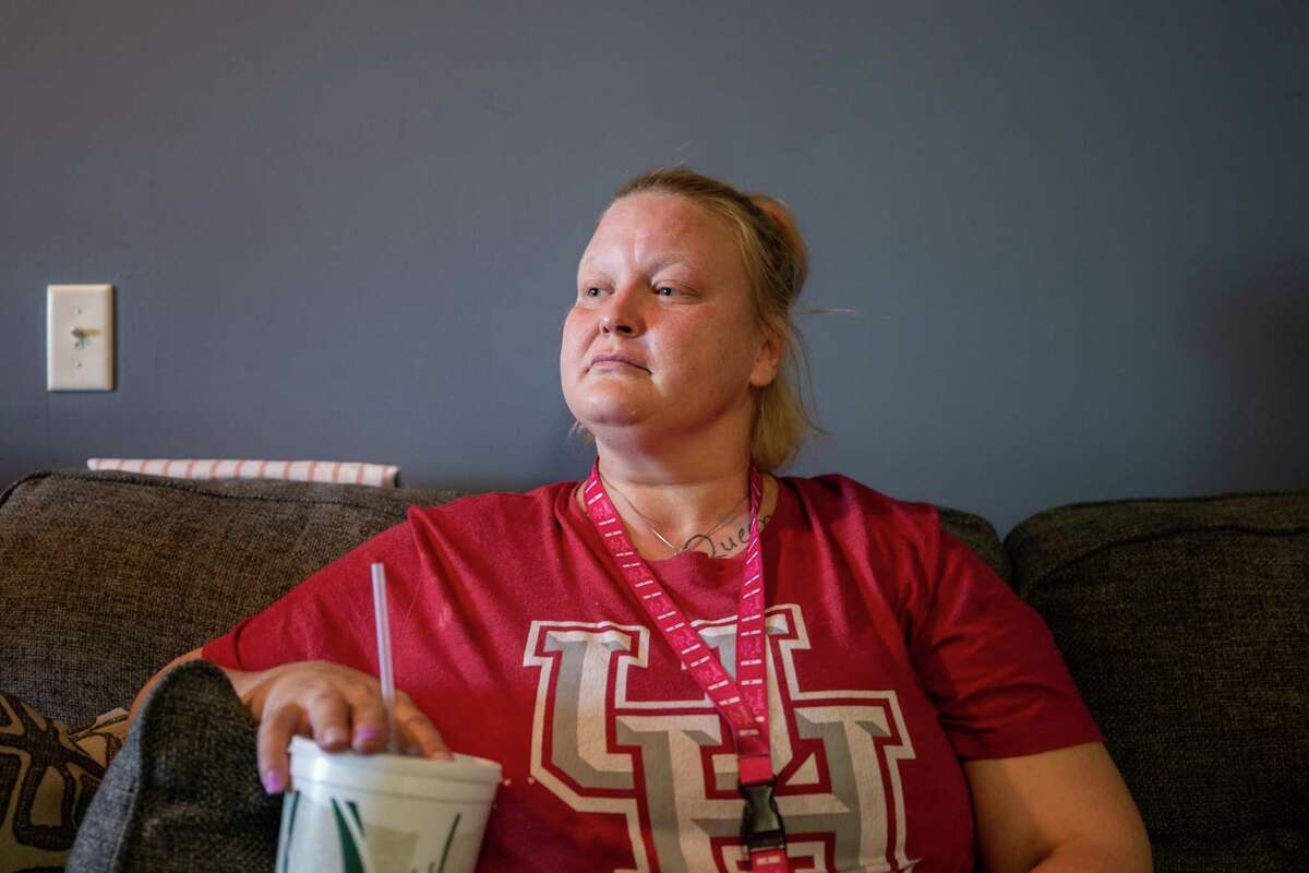 Mindy Johnson sits in her Houston apartment on Nov. 3, 2020. She is a survivor of sex trafficking and hasn?'t had stable housing for nearly two decades.