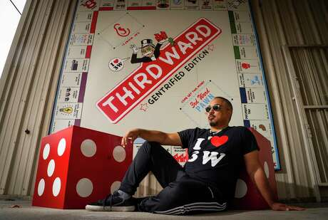 Artist Marc Newsome has his 3rd Ward Gentrification Monopoly board hanging outside the Station Museum of Contemporary Art, Friday, Nov. 13, 2020, in Houston. Newsome started the I Love 3rd Ward Project in 2017 at Project Row Houses.