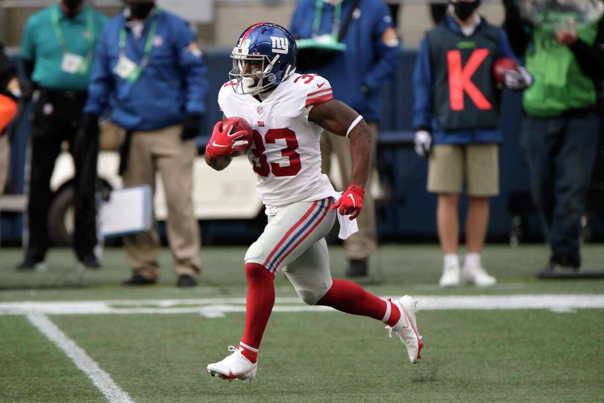 New York Giants running back Dion Lewis runs the ball during the first half of an NFL football game against the Seattle Seahawks, Sunday, Dec. 6, 2020, in Seattle.