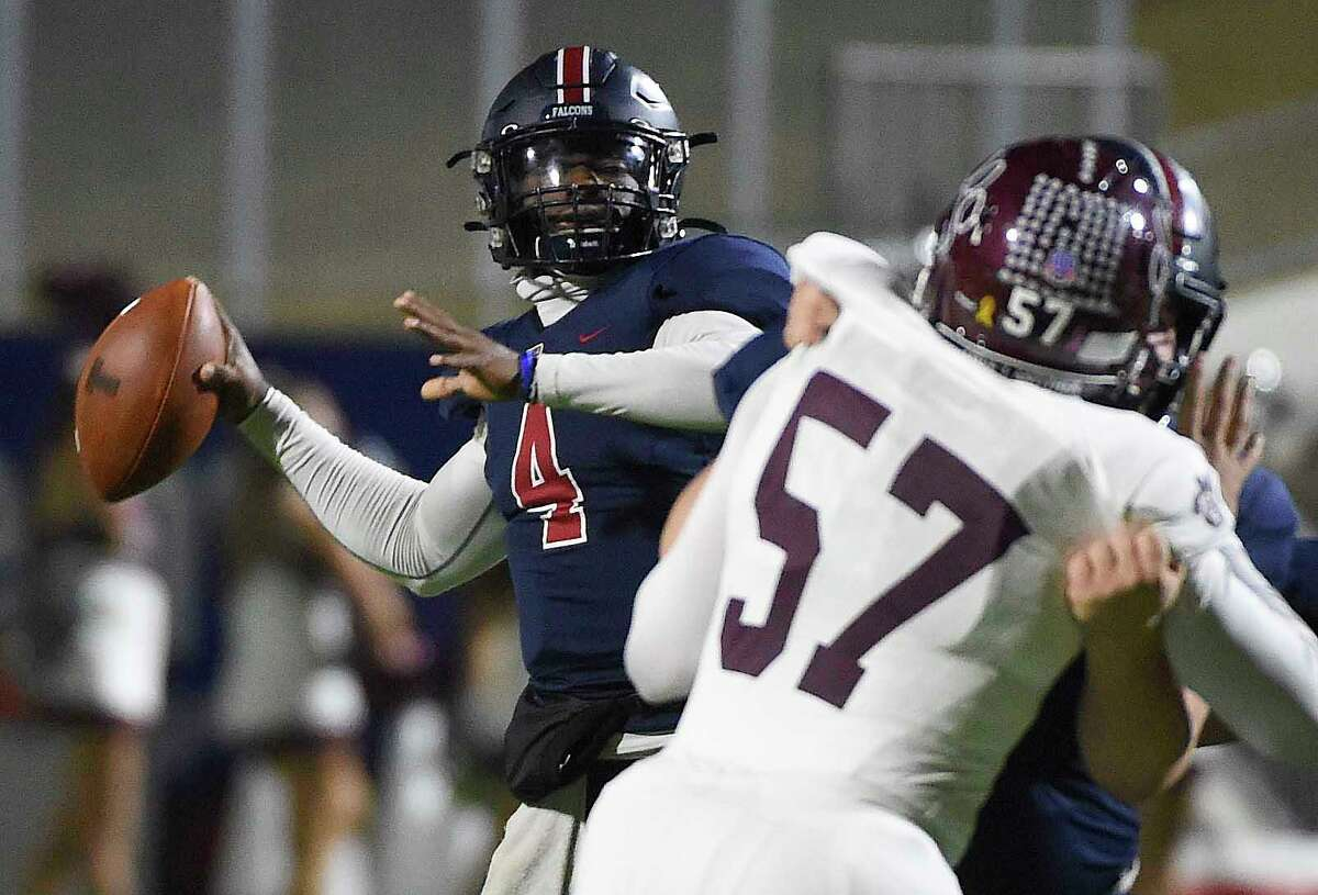 Tompkins quarterback Jalen Milroe (4) throws a pass during the first half of a 6A Division I Region III area round high school football playoff game against Cy-Fair, Friday, Dec. 18, 2020, in Katy, TX.