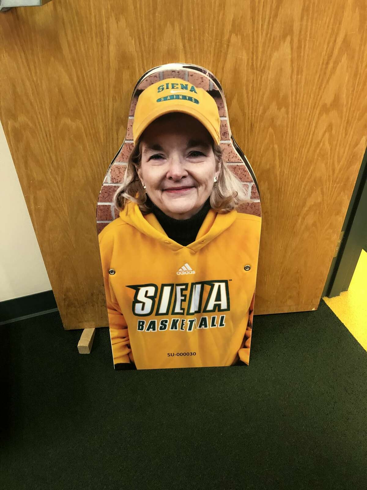 Season-ticket holder Patti Bayly isn't optimistic fans will be allowed this season, but her fan cutout will be attending every game at Alumni Recreation Center. (Photo courtesy of Patti Bayly)