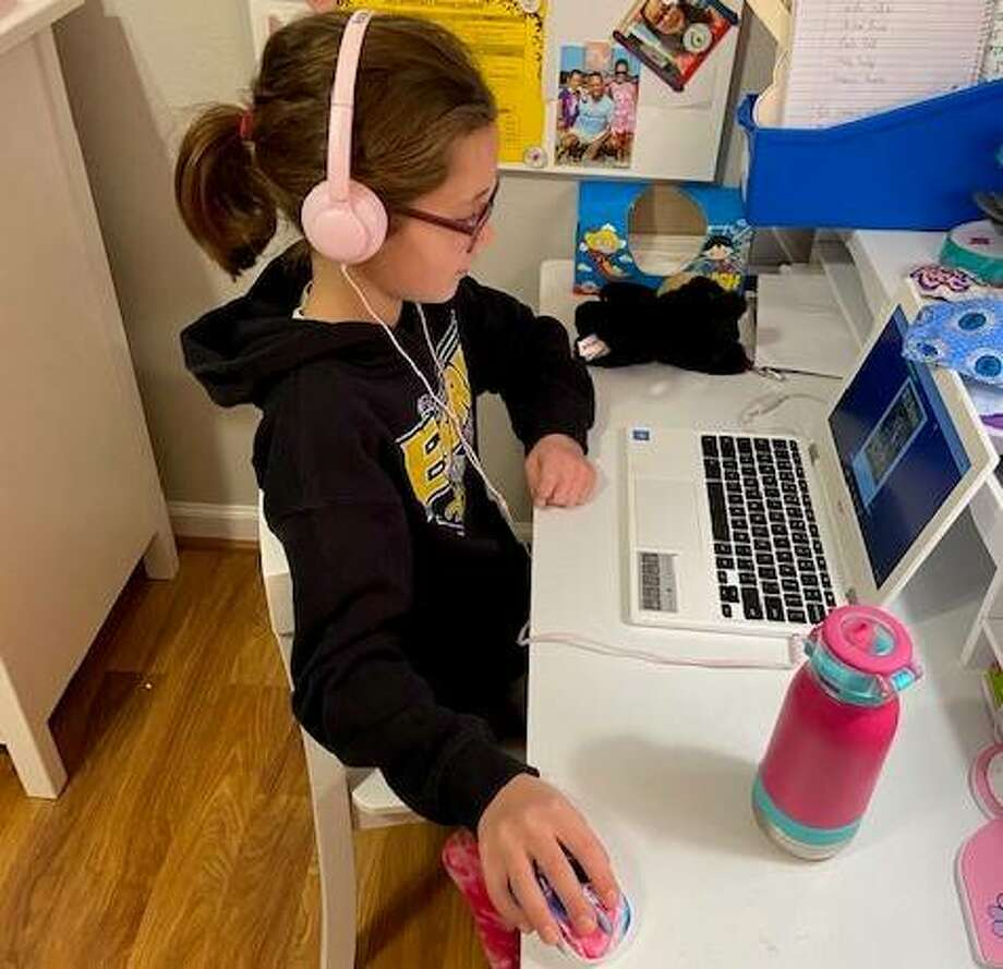 Goshen Elementary student Reese Jackson sits at her desk at home as she listens to her teacher Karla Brinkman give a lesson. Photo: For The Intelligencer