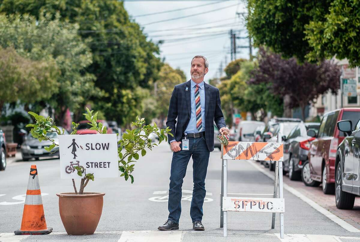 """San Francisco transportation chief Jeffrey Tumlin poses fora photograph on one of the city's designated """"slow streets"""" in San Francisco on Friday, July 3, 2020."""