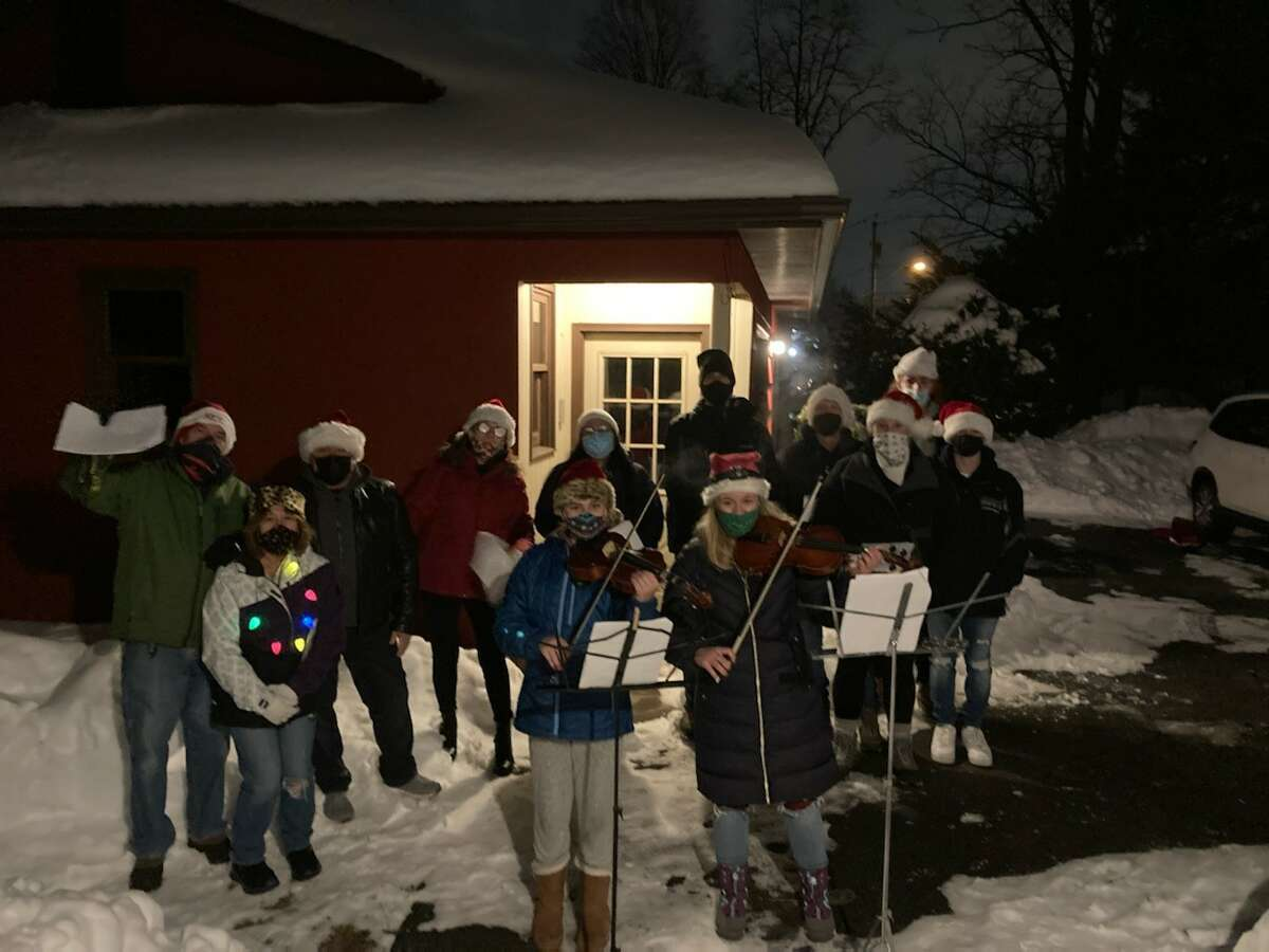 My family got together last night in Colonie to bring some Christmas cheer to my brother and wife who have been 'isolated' since the start of COVID and will not be seeing anyone on Christmas Day. We surprised them, sang Christmas carols and had a viola and violin duet. Carolers are Janet Fisher, Charlie Schoonmaker, Tom, Cindy and April Dahlem, Carrie, Randy and Zach Milano, Christine, Steve and Joshua Renaldi. Musicians: Lauren Fisherand Juliet Renaldi at Herb Dahlem and Ronnie Scott Dahlem's House in Colonie.