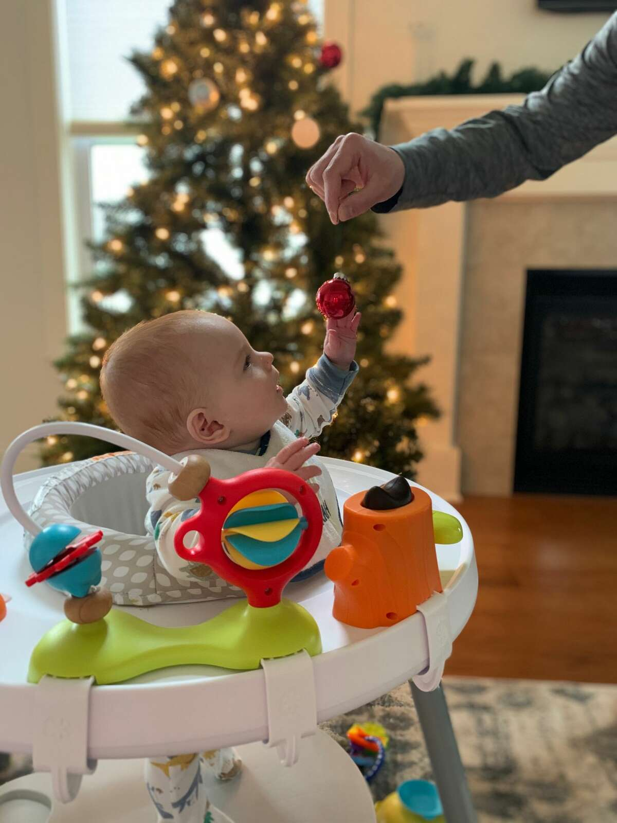 Giovanni Lomaestro, seven-months-old, experiencing Christmas for the first time. He was very intrigued by the Christmas bulb as the family decorated their tree a few weeks ago, says his father, Matt , of Guilderland