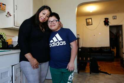 Mejia with her son, Obed, 14, in their apartment.