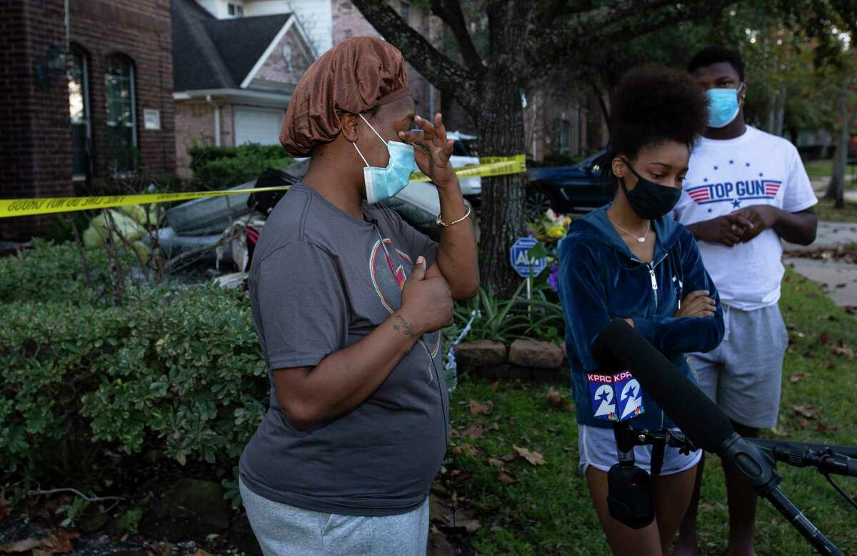 Catherine Modlies, accompanied by her children Therielle Modlies, 18, and Therrence Payne, 15, shares her experience of evacuating a house fire with 10 children at 3 a.m. Wednesday, Dec. 23, 2020, in Cypress. Modlies said she was grateful that all of them get out of the fire safe despite of the fire destroying her rental home.