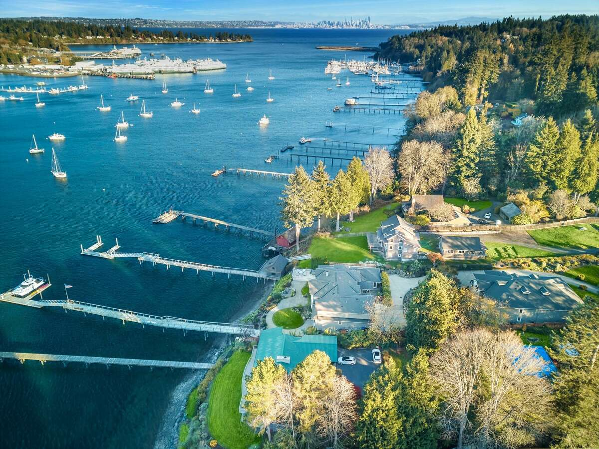 The estate offers .98 acres with 121 feet of waterfront.