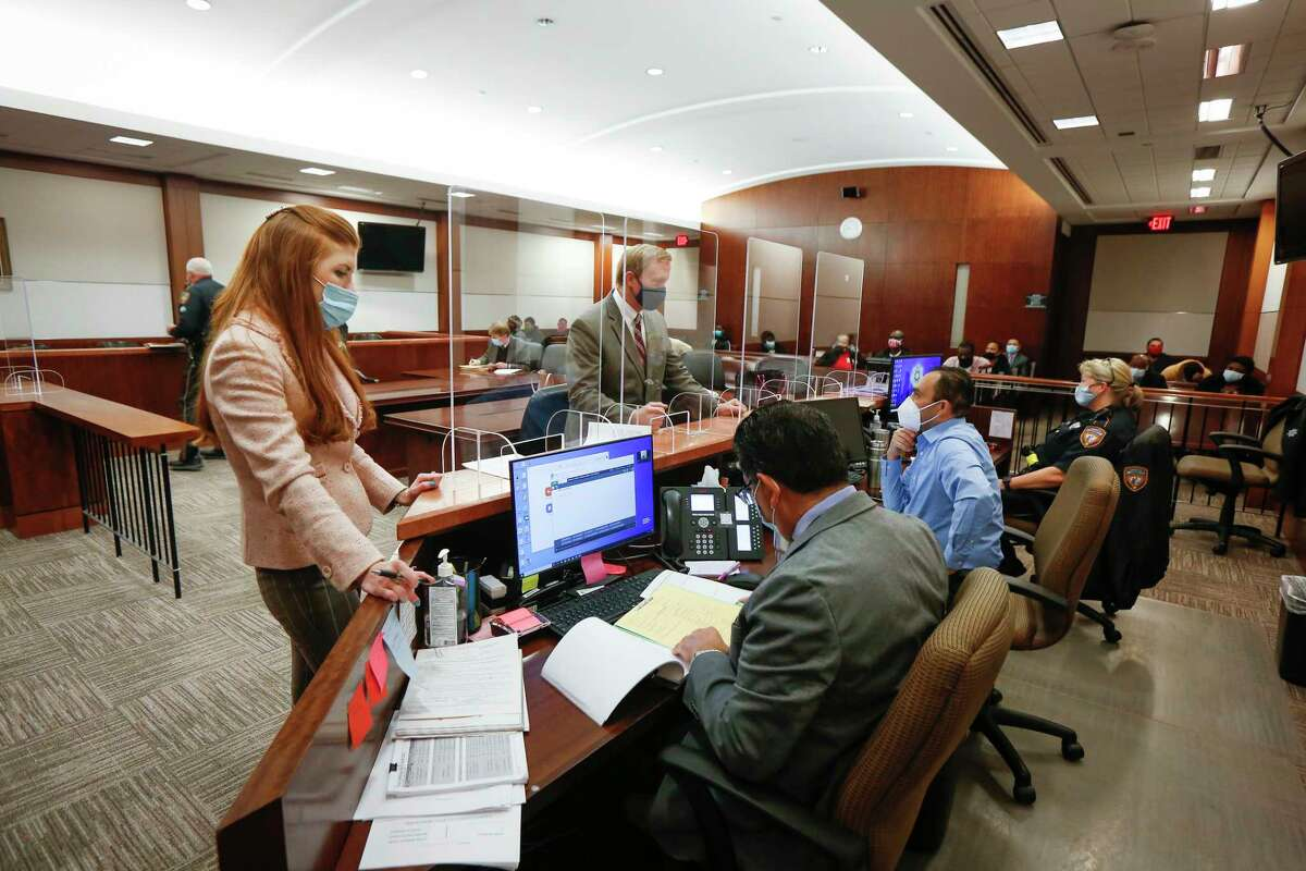 Safety protocol and Zoom hearings are being used in Judge Josh Hill's courtroom in the Harris County Criminal Justice Center 232nd Criminal Court Wednesday, Dec. 16, 2020, in Houston.