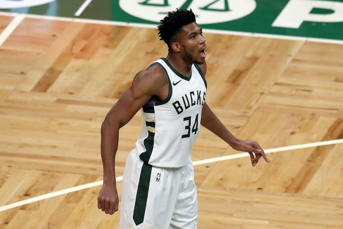 Milwaukee Bucks' Giannis Antetokounmpo plays against the Boston Celtics during the second half of an NBA basketball game, Wednesday, Dec. 23, 2020, in Boston. (AP Photo/Michael Dwyer)