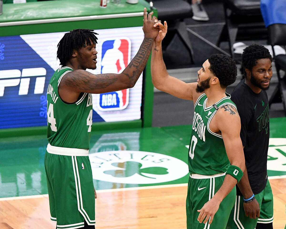 BOSTON, MASSACHUSETTS - DECEMBER 23: Jayson Tatum #0 and Robert Williams III #44 of the Boston Celtics celebrate after defeating the Milwaukee Bucks at TD Garden on December 23, 2020 in Boston, Massachusetts. NOTE TO USER: User expressly acknowledges and agrees that, by downloading and/or using this photograph, user is consenting to the terms and conditions of the Getty Images License Agreement. (Photo by Brian Fluharty-Pool/Getty Images)