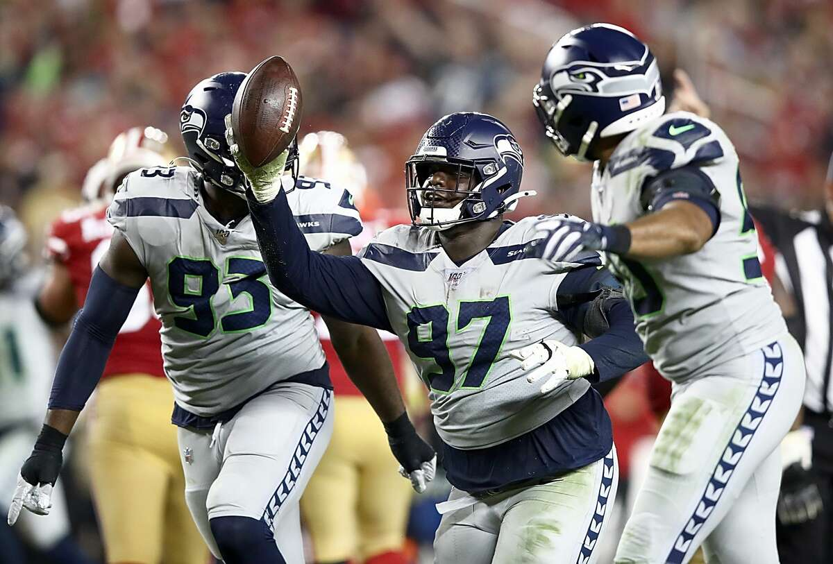 SANTA CLARA, CALIFORNIA - NOVEMBER 11: Defensive tackle Poona Ford #97 of the Seattle Seahawks celebrates a fumble recovery during the game against the San Francisco 49ers at Levi's Stadium on November 11, 2019 in Santa Clara, California. (Photo by Ezra Shaw/Getty Images)