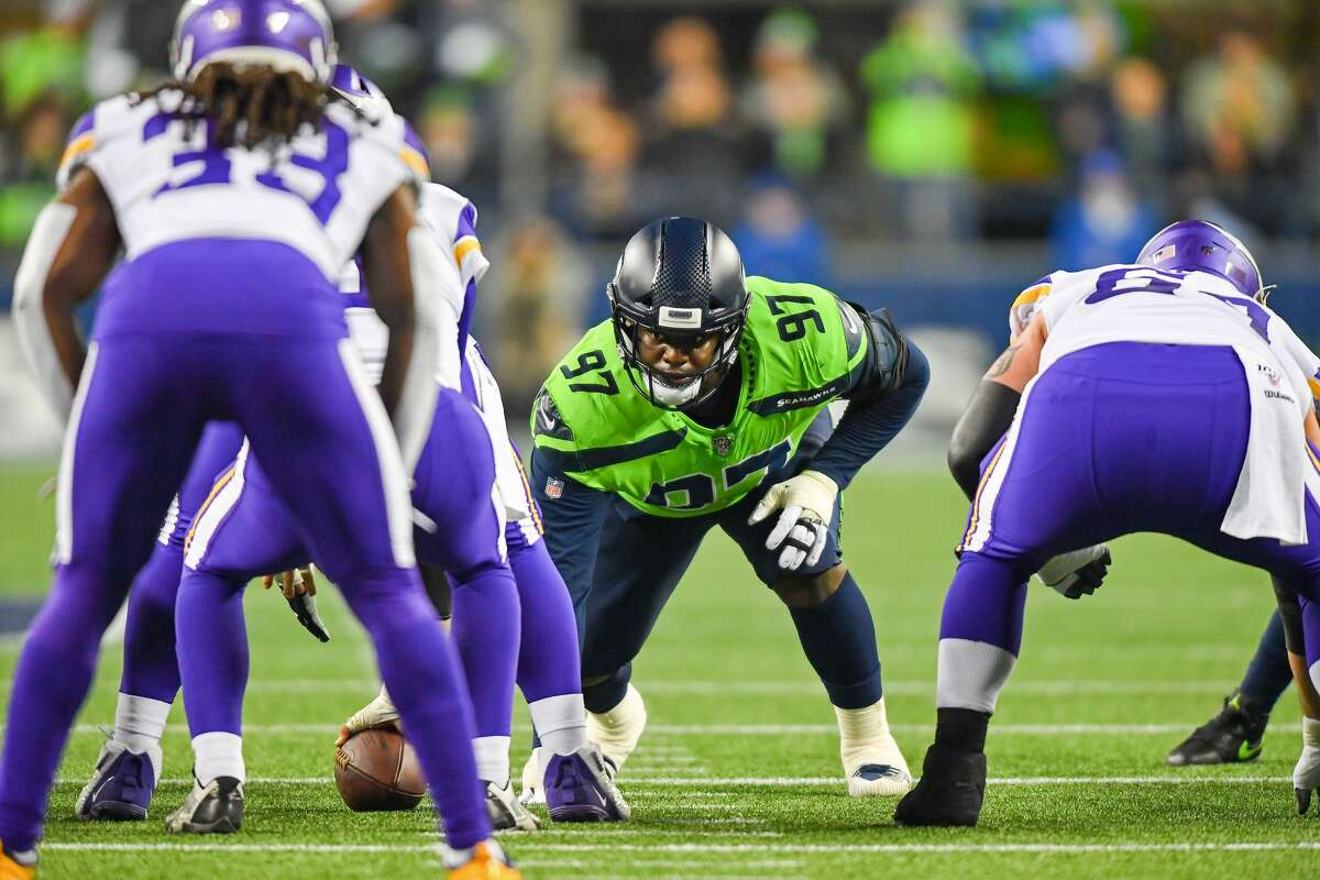 Poona Ford #97 of the Seattle Seahawks awaits the Seattle Seahawks snap during the game at CenturyLink Field on December 02, 2019 in Seattle, Washington.