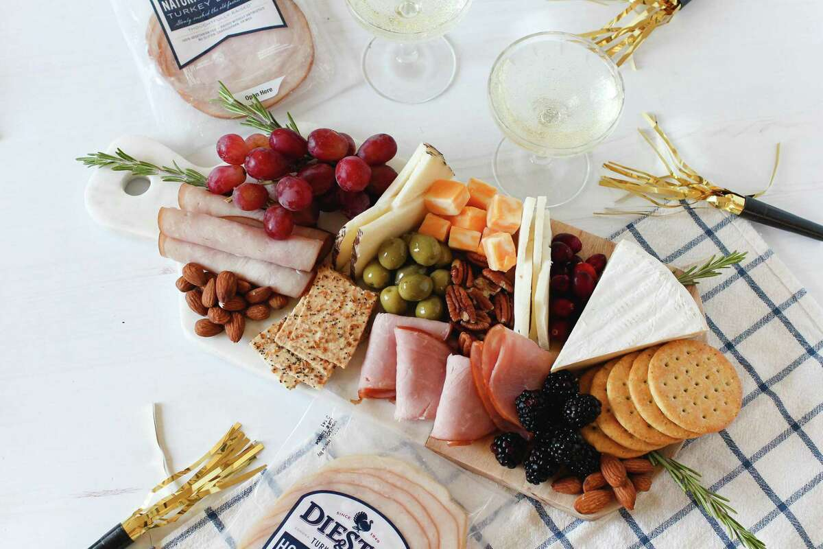 Make a charcuterie board with a variety of meats, aritsan cheeses and crackers.