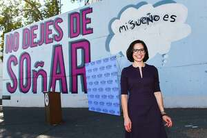 Laredo City Council member Alyssa Cigarroa meets with supporters at a mural on S. Main Avenue after being sworn into office for District VIII on Wednesday, Dec. 23.