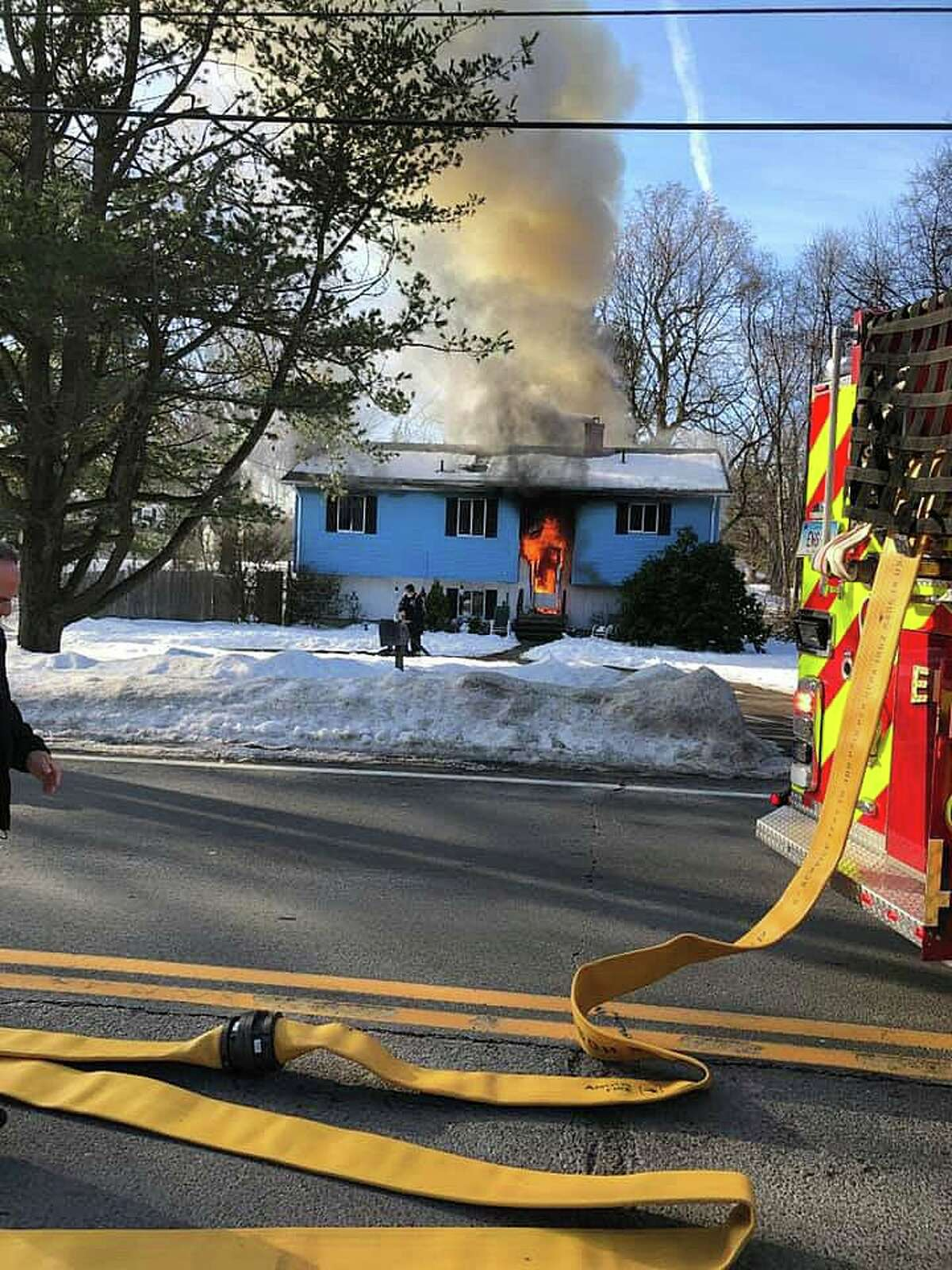 Crews extinguished a fire at a West Main Street home in Cheshire, Conn., on Wednesday, Dec. 23, 2020.