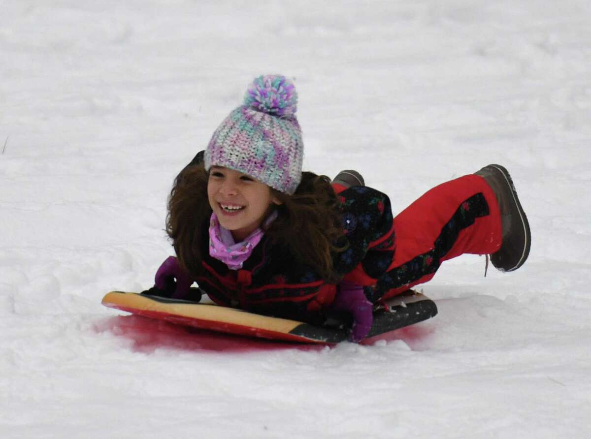 Byram's Heloisa Silva, 6, sleds at Bruce Park in Greenwich, Conn. Sunday, Dec. 20, 2020.