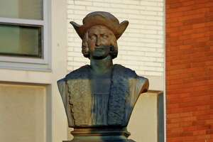 A view the statue of Christopher Columbus in front of Columbus Elementary School in Bridgeport, Conn., on Tuesday Dec. 22, 2020.